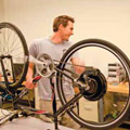 Christopher McNamara of the Electric Bike project developing regenerative braking and battery capacity.
